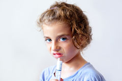 Unhappy kid girl with syringe medicine dose Royalty Free Stock Images