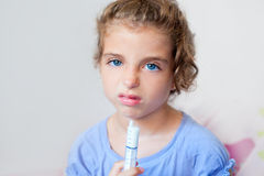 Unhappy kid girl with syringe medicine dose Royalty Free Stock Image