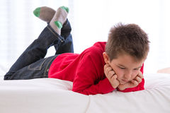 Unhappy Kid Looking Down Stock Images