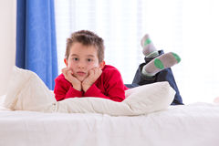 Unhappy Kid Looking Down Stock Image
