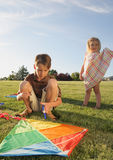 Unhappy Kids. Two unhappy children with a kite outdoors Royalty Free Stock Image