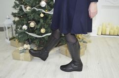 Unhappy lady in black boots royalty free stock photography
