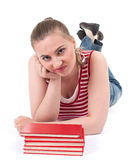 Unhappy lady with stack of red books Royalty Free Stock Photography
