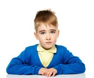 Unhappy little boy in blue cardigan Stock Photography