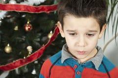 Unhappy little boy on christmass Stock Photos