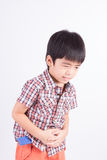 Unhappy Little boy showing stomach pain Royalty Free Stock Image