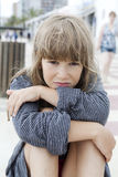 Unhappy little girl. Sitting on bench. Problems with parents Royalty Free Stock Images