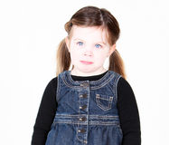 Unhappy little girl. Isolated on white Stock Image