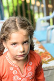 Unhappy little girl. Little girl seems to be not very happy Royalty Free Stock Image