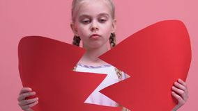 Unhappy little girl trying to fix broken heart, suffering from parents divorce. Stock footage stock footage