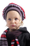 Unhappy little girl with winter hat and coat. Unhappy little girl in winter clothes. Isolated on white Stock Images