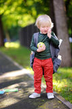 Unhappy little schoolboy on sunny autumn day. Back to school concept. Stock Photo