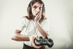 Unhappy male playing games Stock Image
