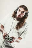 Unhappy male playing games Stock Photo
