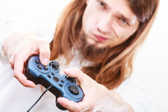 Unhappy male playing games Royalty Free Stock Photo