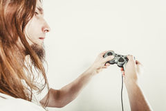 Unhappy male playing games Royalty Free Stock Image