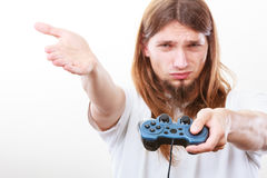 Unhappy male playing games Royalty Free Stock Photography