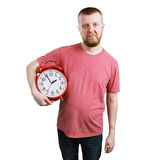 Unhappy man with an alarm clock Royalty Free Stock Images