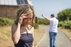 Unhappy man and angry woman leaving after quarrel Royalty Free Stock Images