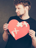 Unhappy man with broken heart. Royalty Free Stock Images