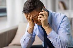 Unhappy man calling on smartphone royalty free stock photos