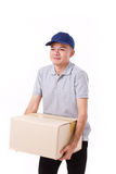 Unhappy man carrying heavy carton box or cardboard box. White isolated background Royalty Free Stock Images