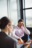 Unhappy man consulting counselor. Unhappy men consulting counselor during therapy royalty free stock photography