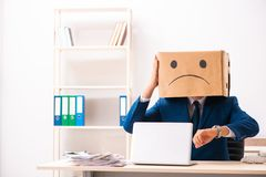 The unhappy man employee with box instead of his head royalty free stock images