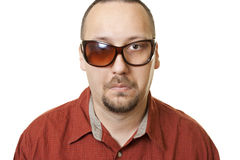 Unhappy man with eyeglasses looking sad Royalty Free Stock Images