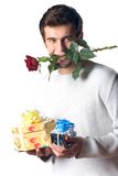 Unhappy man with gifts, rose royalty free stock images