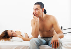 Unhappy man has problem in bed Royalty Free Stock Photo