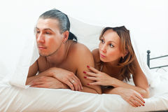Unhappy man has problem under sheet Royalty Free Stock Images