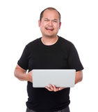 Unhappy man holding laptop computer Stock Photo
