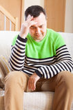 Unhappy man at  home Stock Images