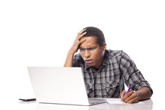 Unhappy man on a laptop Royalty Free Stock Image