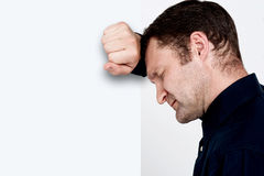 Unhappy man leaning at the wall Stock Photos