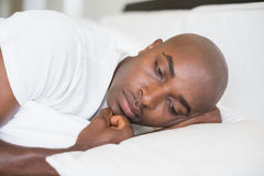 Unhappy man lying in bed Royalty Free Stock Photos