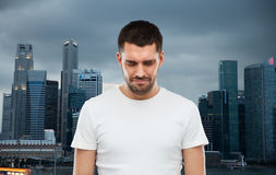 Unhappy man over evening singapore city background Stock Image