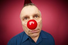Unhappy man with red nose Stock Images