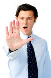 Unhappy man stretches his arm in a stop gesture Stock Image
