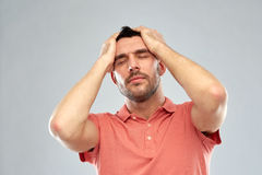 Unhappy man suffering from head ache Royalty Free Stock Photos