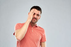 Unhappy man suffering from head ache Royalty Free Stock Images