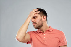 Unhappy man suffering from head ache Stock Photo