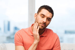 Unhappy man suffering toothache at home Royalty Free Stock Photo