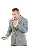 Unhappy man in suit with headset and telephone Royalty Free Stock Photos