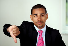 Unhappy man thumbs down Royalty Free Stock Photos