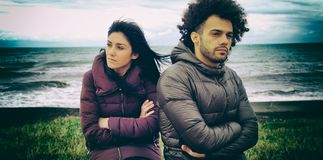 Unhappy man and woman outdoors after fight in front of the ocean Royalty Free Stock Images