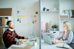 Unhappy marketing specialists working in office royalty free stock photos