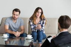 Unhappy married couple counseling, woman talking to psychologist stock image