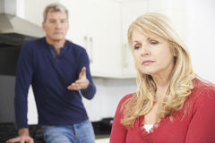 Unhappy Mature Couple Having Arguement At Home Royalty Free Stock Image